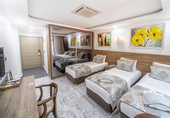 3-kisilik-odalar-3-tekli-yatak